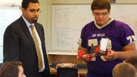 Student shows Dr. King a rubberband car