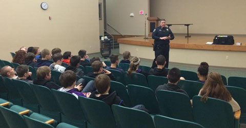 students hear presentation by officer