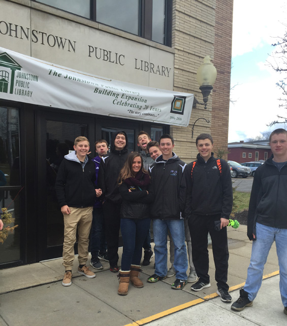 students stand outside public library