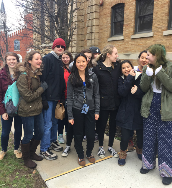 larger group of students outside of library