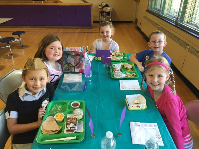 students enjoying dessert