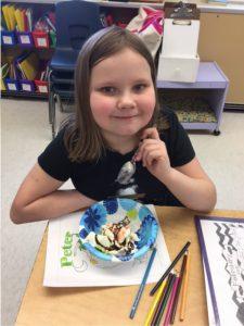 girl at desk with ice cream sundae