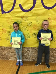 boy and girl musicians of the month with certificates