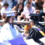 female student accepts her diploma