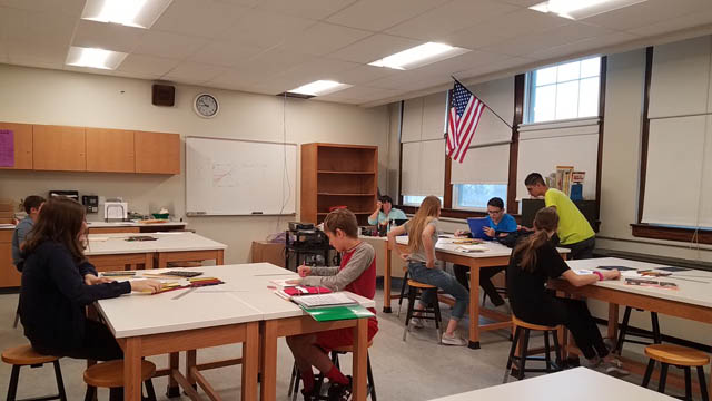 students sit at tables in Knox classroom