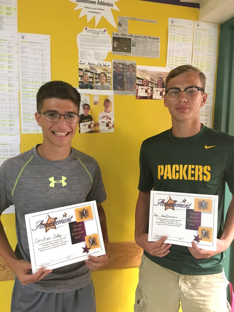 Christian Solby and Alex VanDeusen hold certificates