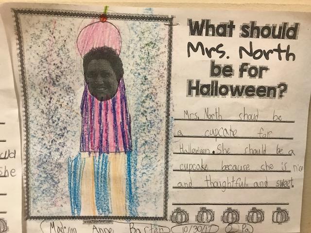 cupcake drawn around Mrs. North's face