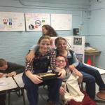 three girls sitting on table