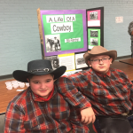 two boys in cowboy hats