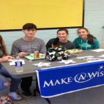 another group of students at Make a Wish table
