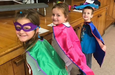 three students with capes