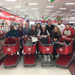 students line up with shopping carts for group photo at Target store