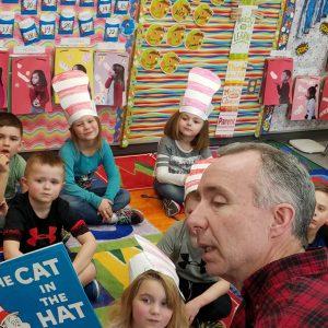 Tom Roehl reading to children