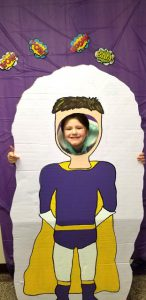 student in super-hero photo booth