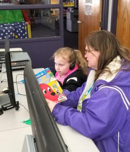 parent and child at computer