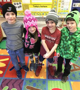 four students with hats