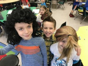 a group of students, one with a wig