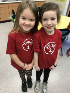 two girls with thing 1 shirts