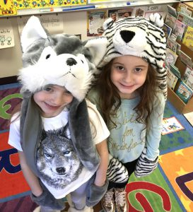 two girls in animal hats