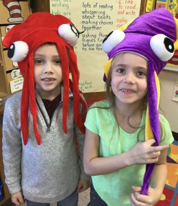two students with weird hats