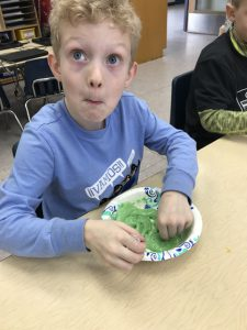 boy with bowl of slime