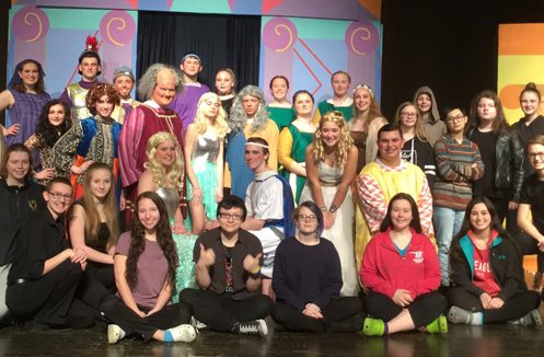 cast and crew pose on stage for group shot