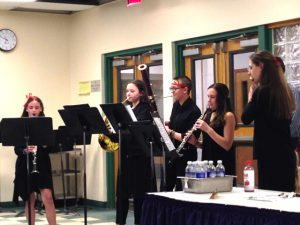 Knox Winds performing at Board meeting