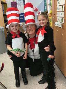 Principal Cotter with two students in Cat in the Hat outfits