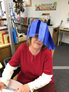 staff member with blue wig
