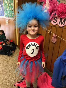 girl with blue wig and red & blue tutu