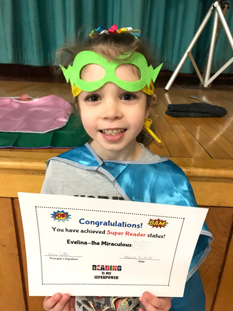 girl with mask, cape and certificate