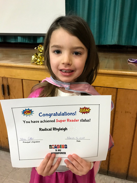 girl with certificate and cape