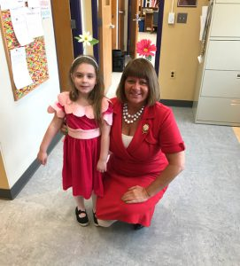 teacher and student dressed in red
