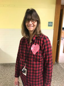 staff member with a number pinned to her shirt