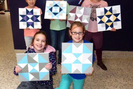 Enrichment Group Designs & Paints Quilt Squares
