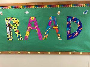 """letters """"RAAD"""" on hall wall"""