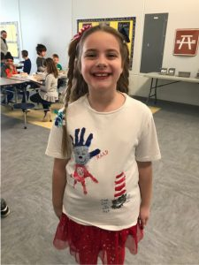 girl with Dr. Seuss characters hand painted on white t-shirt
