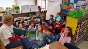 guest reader reading book to students