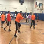 Principal Satterlee serving the ball