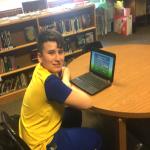 boy sitting at laptop