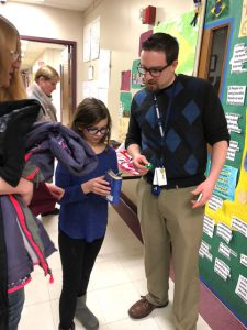 student reviewing her passport