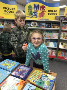 siblings at book fair