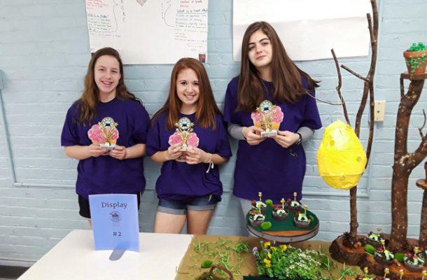 three girls holding cupcakes