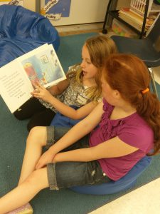 two more girls reading on bean bags