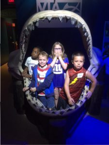 same kids in a shark's mouth