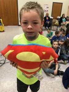 boy with Superman shield