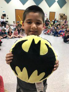 boy with batman shield