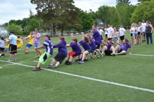 students participate in tug of war