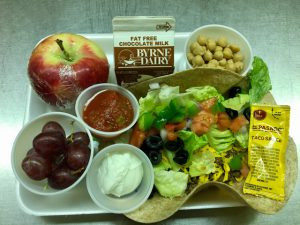 cafeteria tray with full loaded taco, extra fruits and veggies