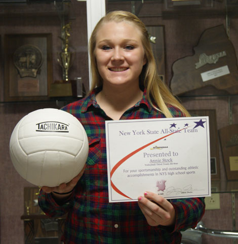 Annie with volleyball and certificate